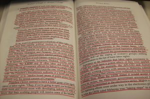 One of many books with bright red underlining that covers almost the entire page of all the pages.